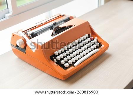 Retro old typewriter on wooden table  - stock photo