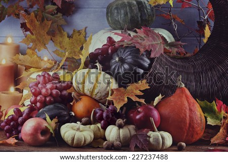 Retro or vintage image of a Cornucopia or Horn of Plenty with lots of fresh vegetables and fruit spilling out. - stock photo