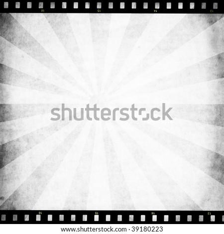 Retro paper with sunburst and film strip - stock photo