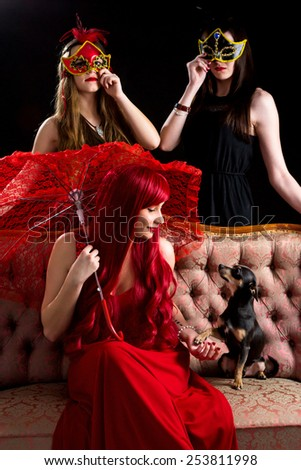 Retro party girls with puppy dog - stock photo