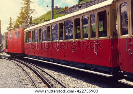Retro passenger train departs from Schynige Platte to Interlaken. Switzerland. - stock photo
