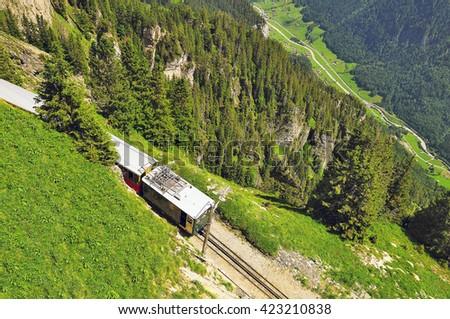 Retro passenger train moves from Schynige Platte to Interlaken. Switzerland. - stock photo