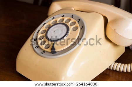 Retro pastel telephone on wooden table - stock photo