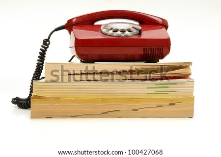 retro phone and phone book............ - stock photo
