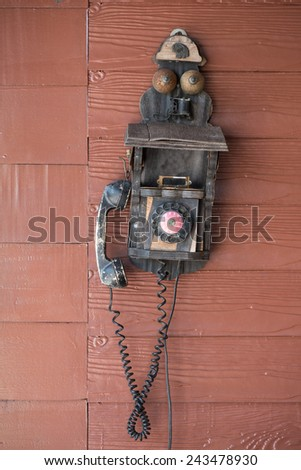 retro phone hangs on a wood background  - stock photo