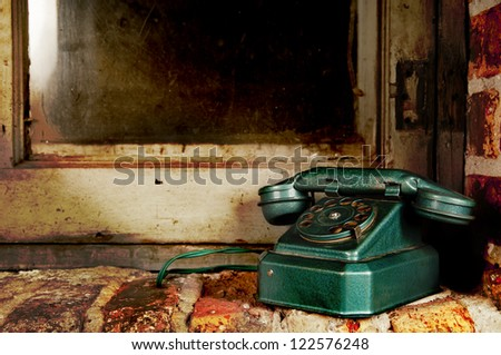Retro Phone - Vintage Telephone by Old Grunge Window and Brick Wall - stock photo