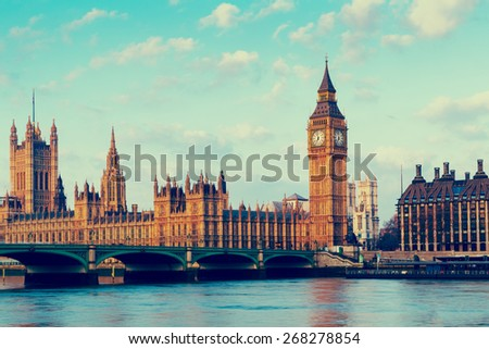 Retro Photo Filter Effect - Elizabeth Tower, Big Ben and Westminster Bridge in early morning light, London, England, UK - stock photo