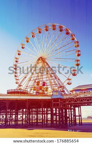 Retro Photo Filter Effect Ferris Wheel on Central Pier, Blackpool, Lancashire, UK - stock photo