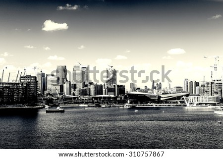 RETRO PHOTO FILTER EFFECT: View of the City of London and Isle of Dogs from The Victoria Docks, London, England, UK