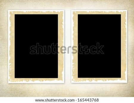 retro photo frames against a grungy old looking background  - stock photo