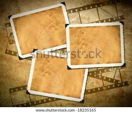 Retro photo framework against an old paper with filmstrip - stock photo