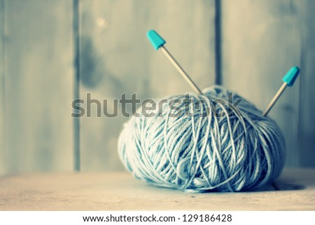Retro photo of blue ball of wool - stock photo