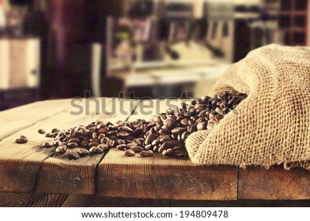 retro photo of coffee and old sack with beans  - stock photo