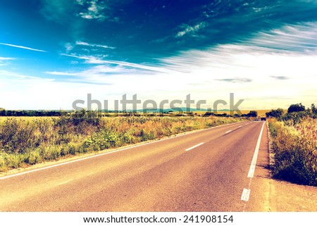 Retro Photo Of Country Road Landscape In Summer - stock photo