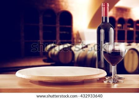 retro photo of few barrels and wine on desk  - stock photo