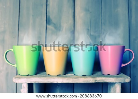 Retro photo of four cute tea  mugs - stock photo