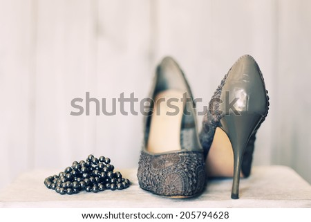 Retro photo of grey shoes - stock photo