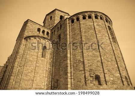 Retro photo of old medieval castle. Castle of Cardona - stock photo