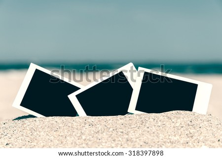 Retro Photo Of White Blank Instant Photo Cards On Beach Sand In Summer