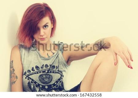 retro photo of young tattooed girl - stock photo
