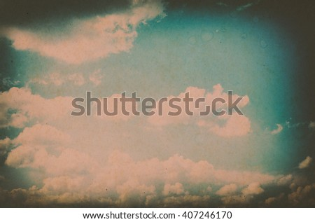 Retro photo with noisy texture. Blue sky with clouds. The sky with clouds for background. Nature background