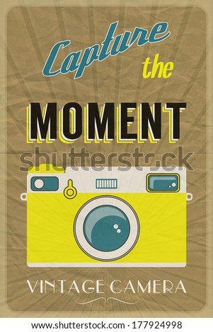 Retro photographic poster with the slogan Capture the Moment, on crumpled brown paper background. Also available in vector format - stock photo