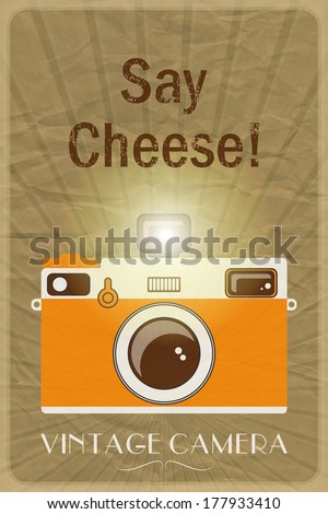 Retro photographic poster with the slogan Say Cheese!, on crumpled brown paper background.  - stock photo