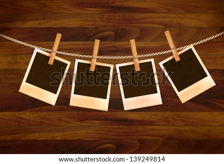 Retro photos hanging on a rope on dark wooden background. Raster version of vector. - stock photo