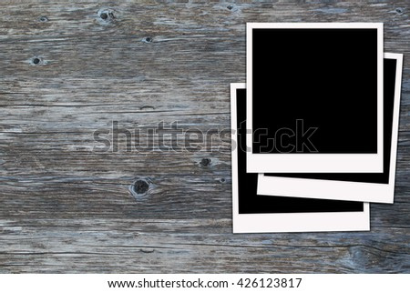 Retro pictureframes isolated on wooden texture background