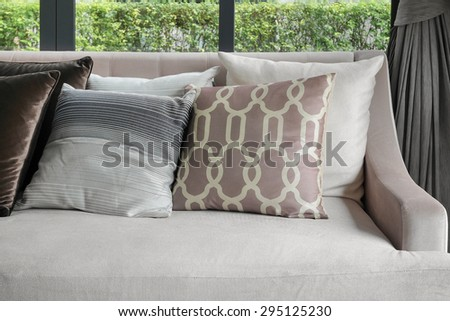Retro pillows on the cozy brown sofa in the living room