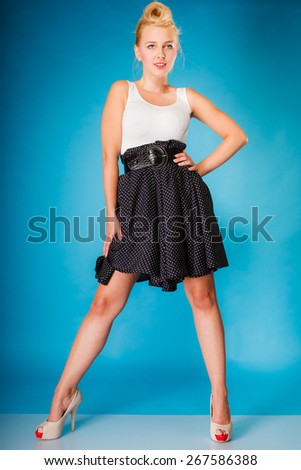 Retro pin up woman style. Beauty young full length girl on blue background in studio. - stock photo