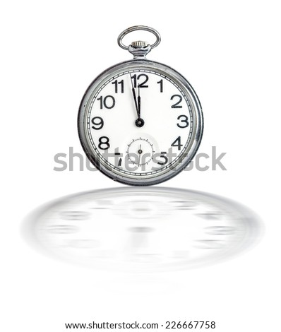 Retro pocket watch showing two minutes to twelve on white with clock face reflection on surface
