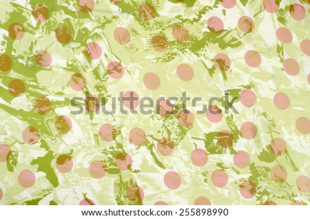 Retro polka dots pattern. Pink dots on green fabric as background. - stock photo