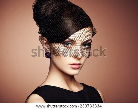 Retro portrait of a beautiful woman. Vintage style. Perfect make-up. Fashion photo - stock photo