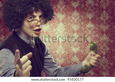 Retro portrait of a young man on the phone - stock photo