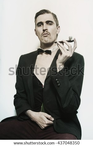 Retro portrait of an adult man smoking a pipe closeup - stock photo