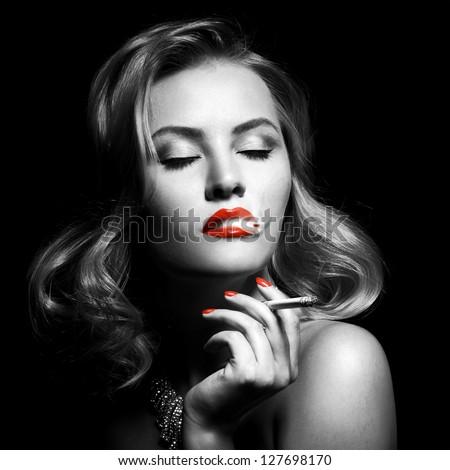 Retro Portrait Of Beautiful Woman With Cigarette - stock photo