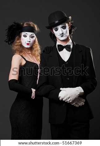 retro portrait of mimes over black background - stock photo