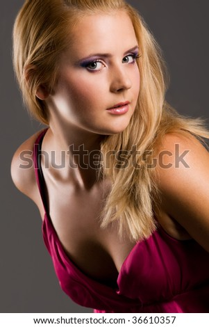 Retro portrait of sweet alluring blond in red - stock photo