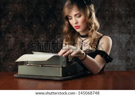retro portrait, woman and vintage typewriter - stock photo