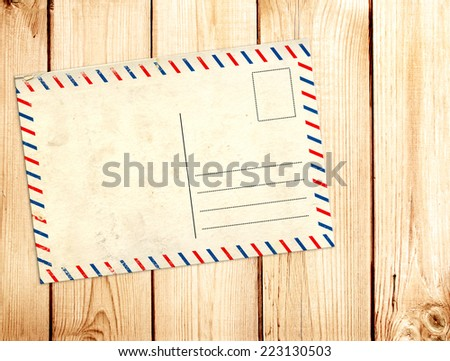 Retro post card on wooden planks