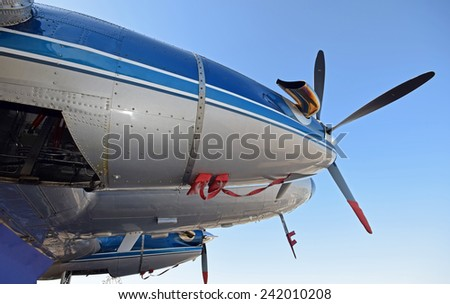 Retro propeller airplane engine and nose view - stock photo