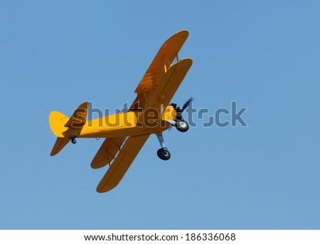 Retro propeller airplane in flight painted yellow - stock photo