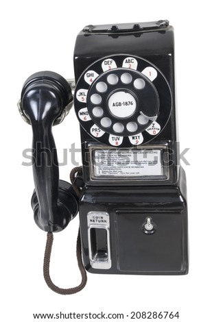 Retro public pay telephone used to make phone calls - path included - stock photo