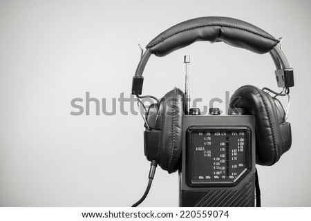 Retro radio and headphones. Black and white photo - stock photo