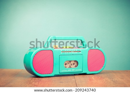 Retro radio cassette recorder front mint green background - stock photo