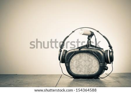 Retro radio, headphones and microphone old style sepia photo - stock photo