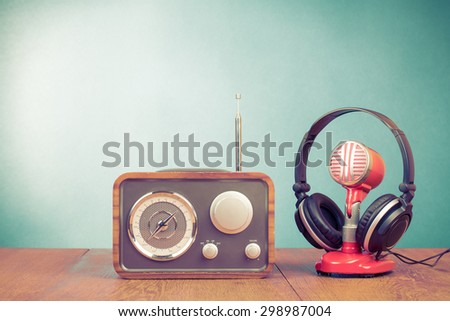 Retro radio, old microphone from 60s and old headphones front mint green background. Vintage instagram style filtered photo - stock photo