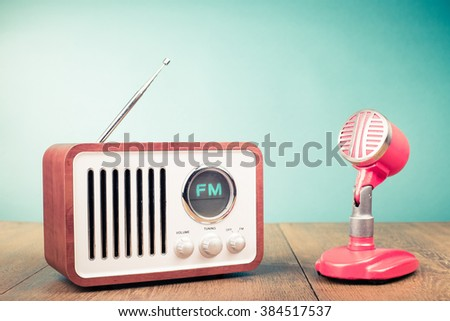 Retro radio, old microphone from 60s front mint green background. Vintage style filtered photo