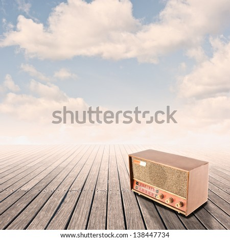 retro radio on pier with sky on sunset - stock photo